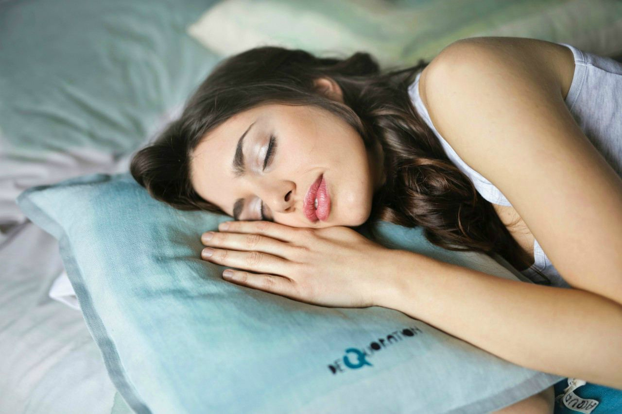 An image of a woman asleep in bed