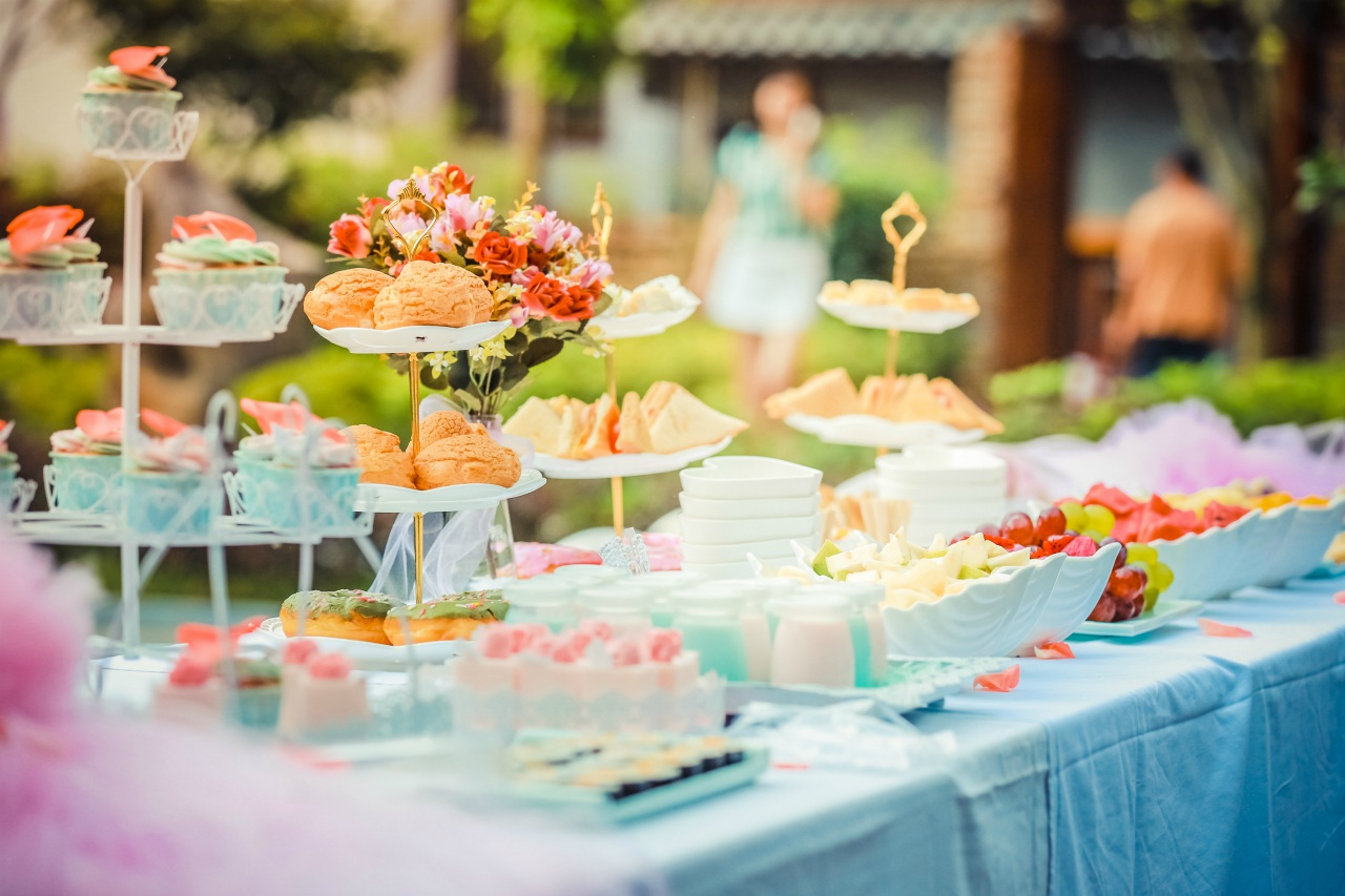 An image of a table of various foods at an outdoor party