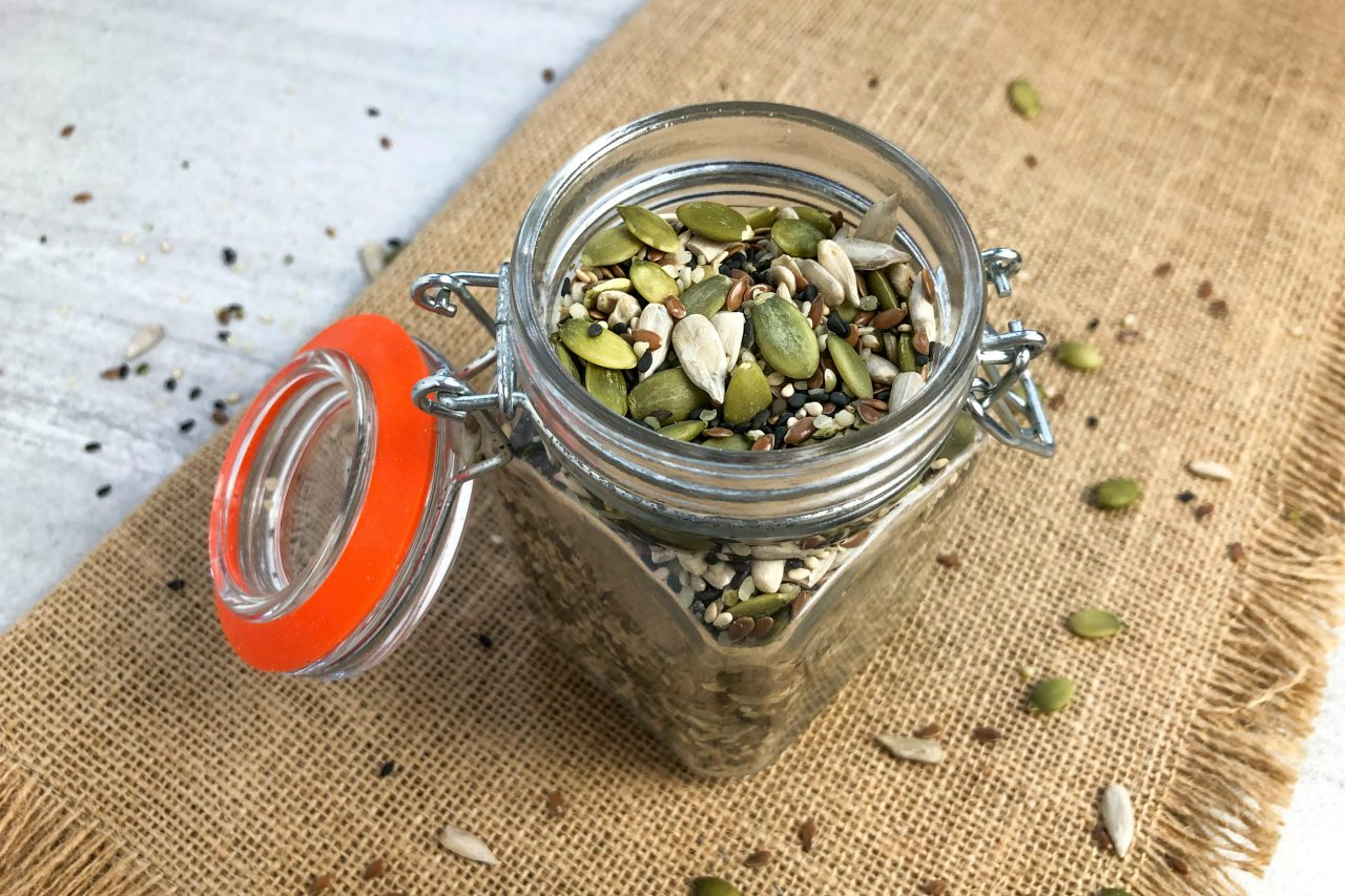 An image of a jar of mixed seeds.