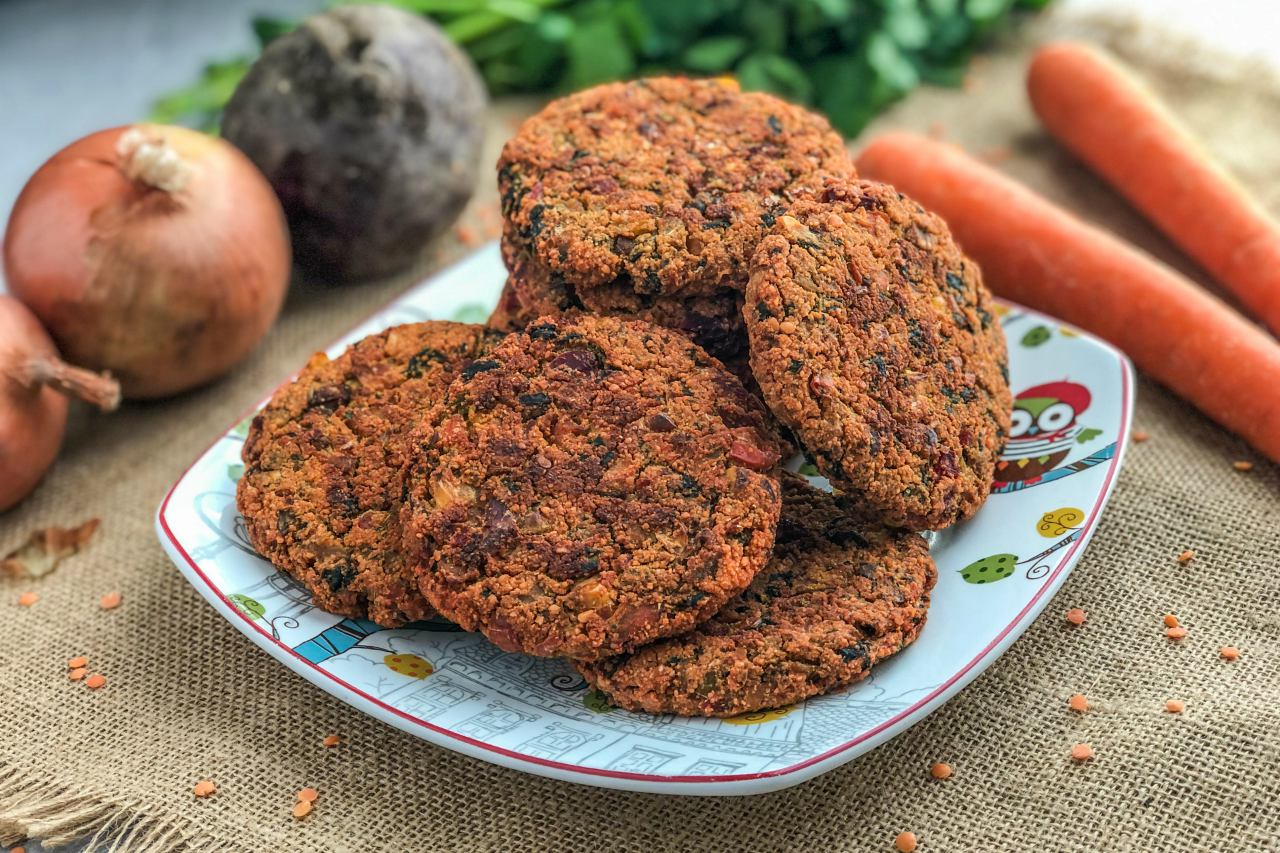 An image of a plate full of Red Lentil Veggie Burgers.